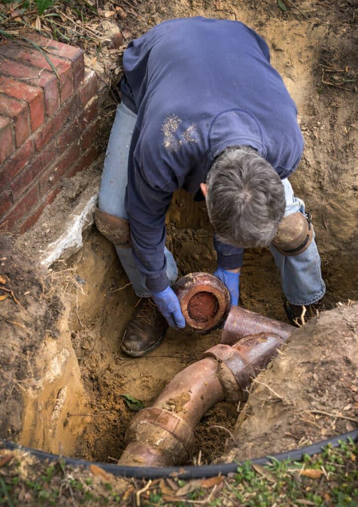 plumber performing sewer pipe repair in salt lake city